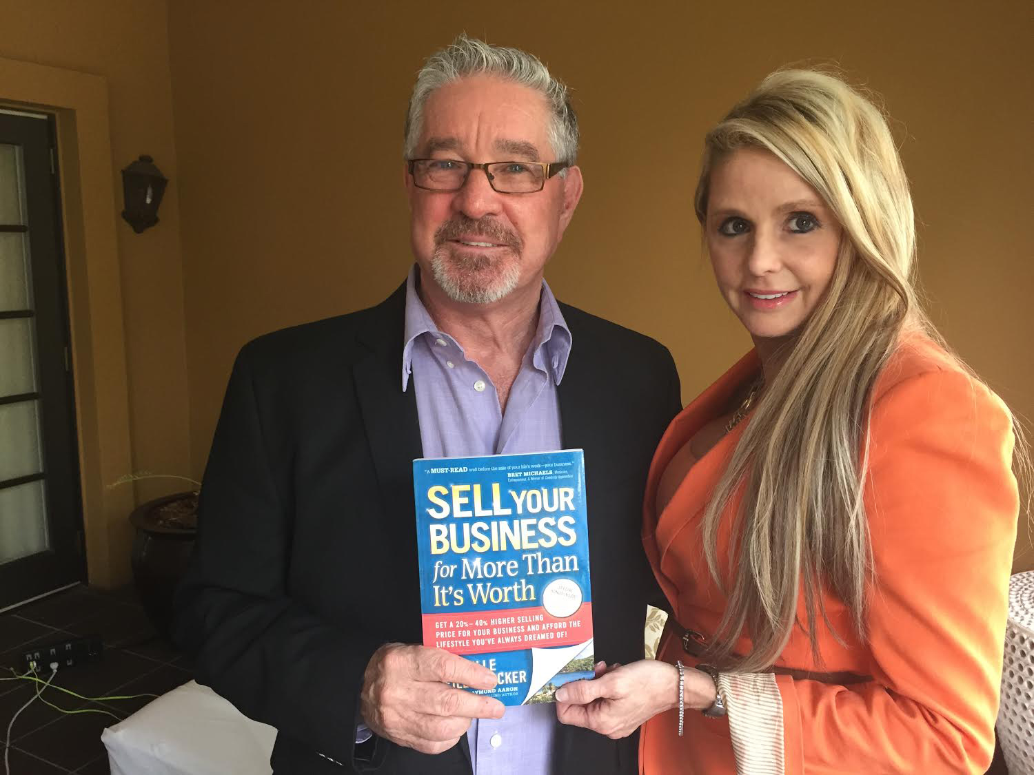 Michelle Seiler-Tucker with Berny Dohrmann, founder and CEO of CEO Space International, which gives prospective business leaders the tools and education they need to succeed in the future